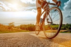 Cyclist rides his bike up a steep hill